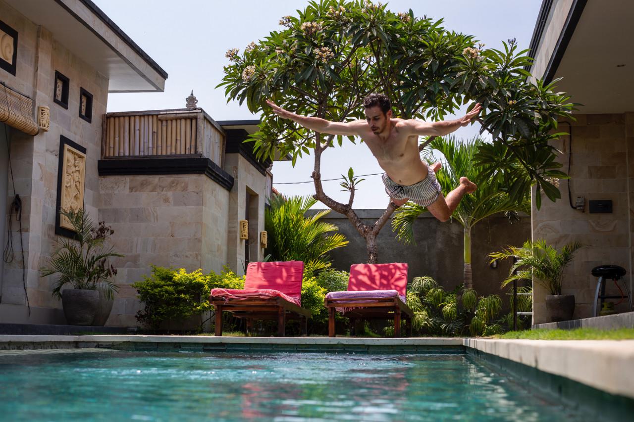 Man jumping into pool